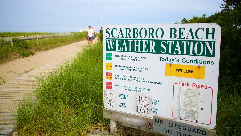 Scarborough Beach State Park featuring a sandy beach, general coastal views and signage