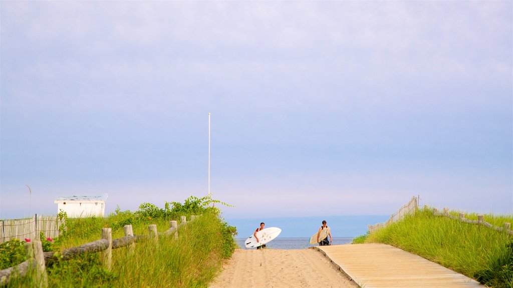 Scarborough Beach State Park which includes a sandy beach, surfing and general coastal views