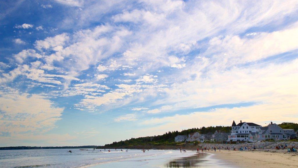 Higgins Beach showing a coastal town, a beach and a sunset