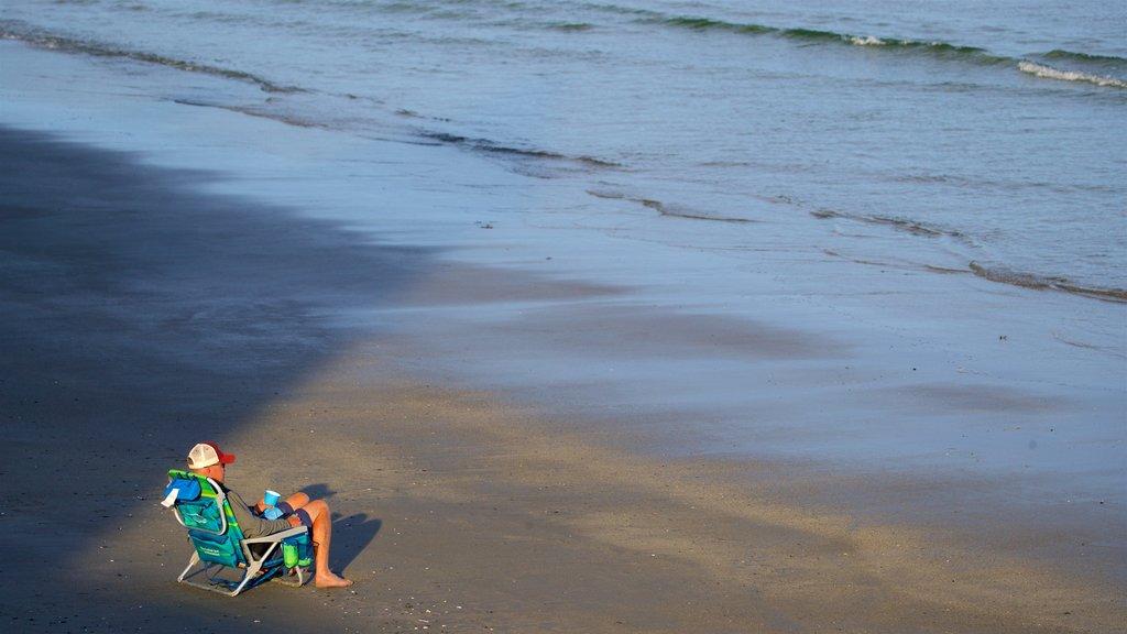 Higgins Beach showing a sandy beach and general coastal views as well as an individual male