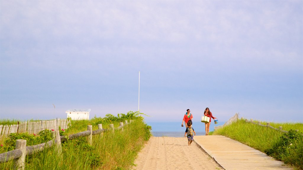 Scarborough Beach State Park featuring general coastal views as well as a family