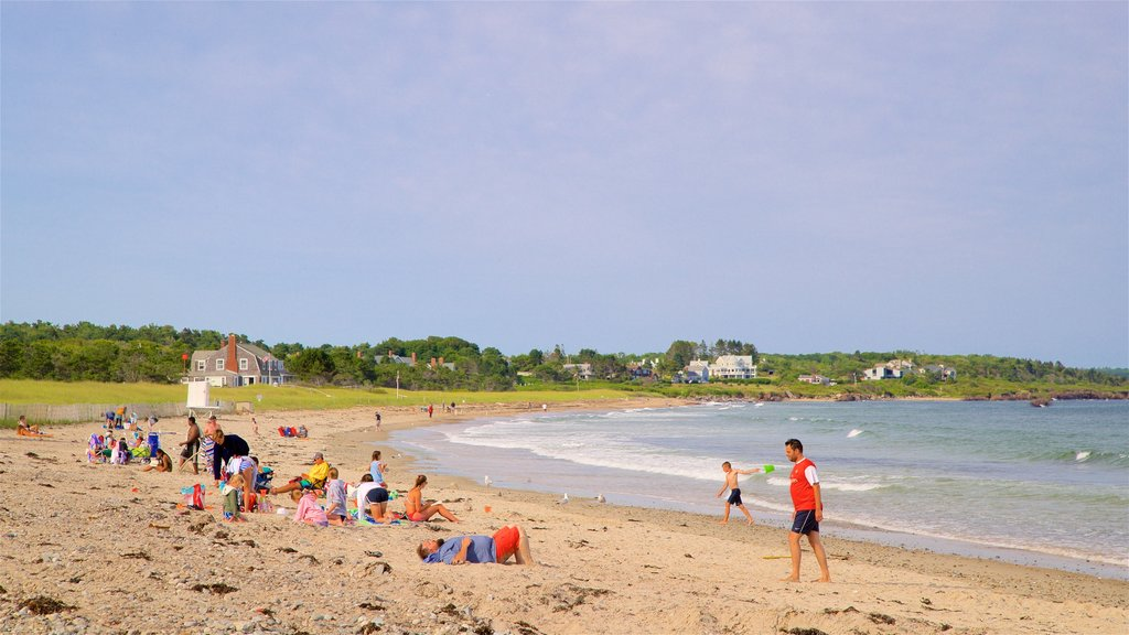 Scarborough Beach State Park featuring general coastal views and a sandy beach as well as a small group of people