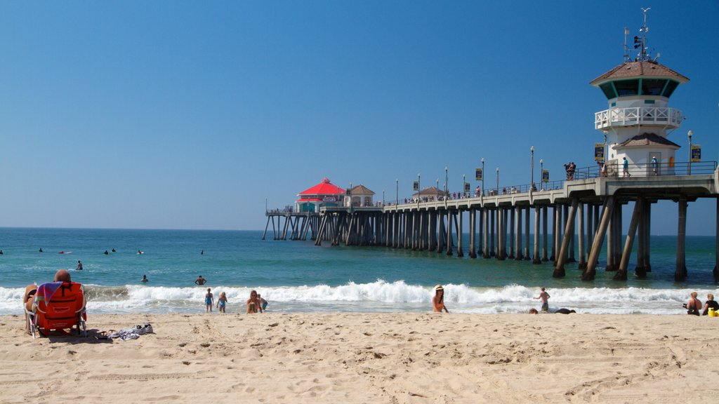 Huntington Beach featuring landscape views, swimming and a lighthouse
