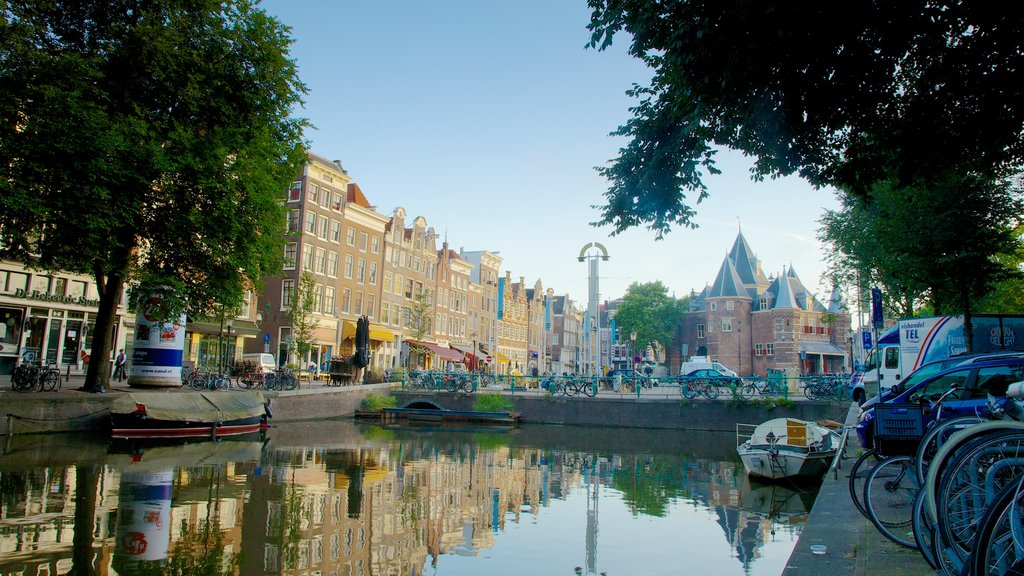 Nieuwmarkt Square featuring boating, a lake or waterhole and a city