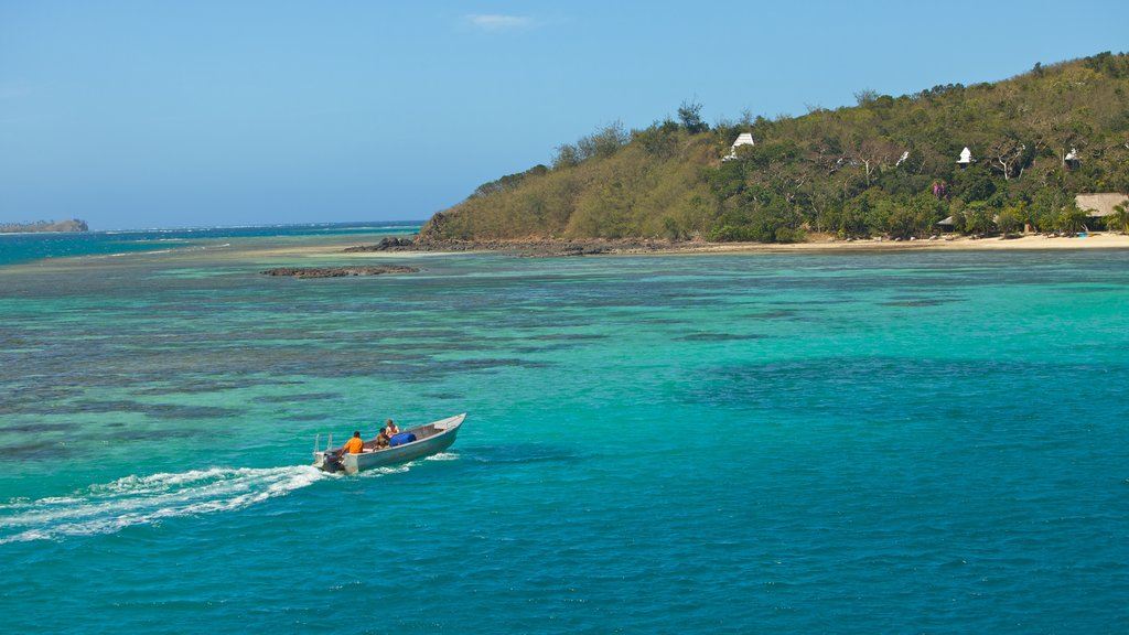 Nacula Island featuring tropical scenes, island images and boating
