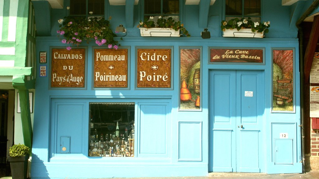Honfleur featuring signage and cafe lifestyle