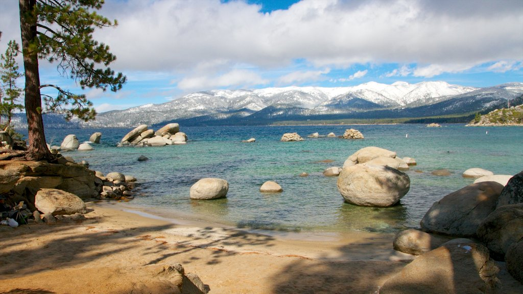 Sand Harbor of Lake Tahoe Nevada State Park featuring landscape views, a beach and mountains