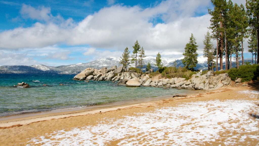 Sand Harbor of Lake Tahoe Nevada State Park featuring a bay or harbor, a sandy beach and landscape views