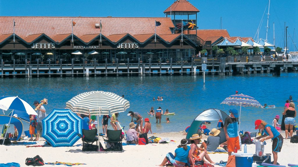 Hillarys which includes a sandy beach as well as a large group of people