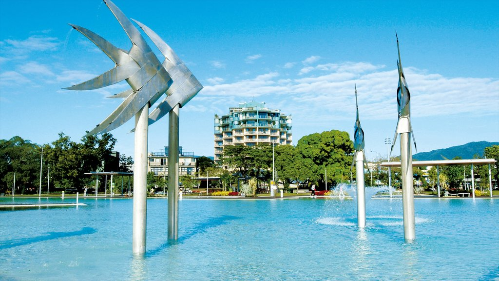 Cairns Esplanade showing outdoor art, a pool and a luxury hotel or resort
