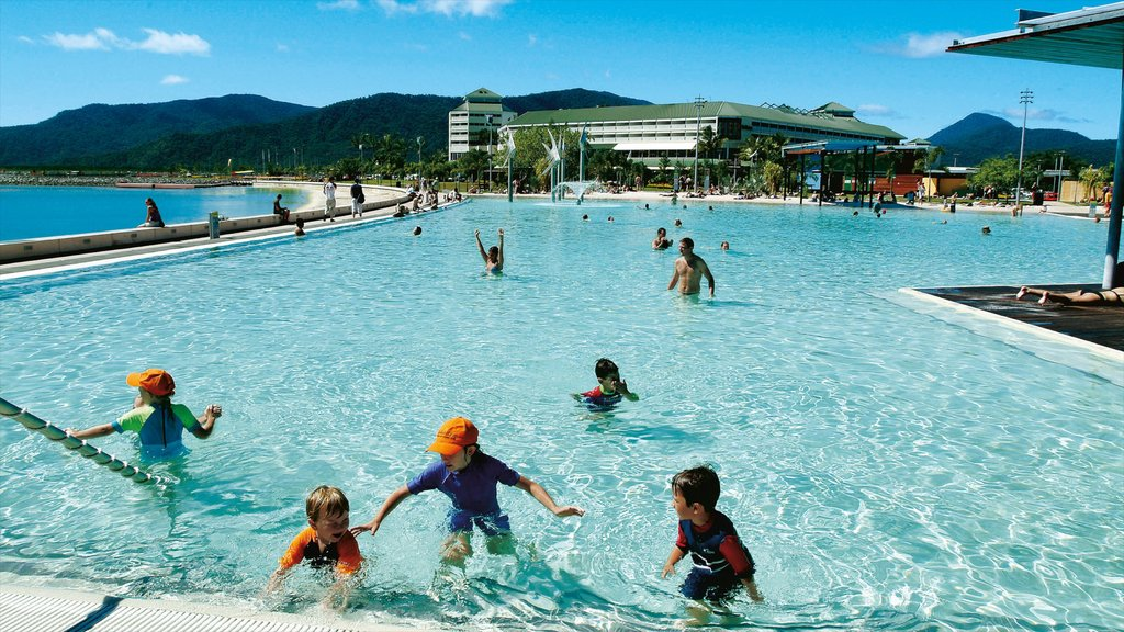 Cairns Esplanade which includes a pool, swimming and a luxury hotel or resort