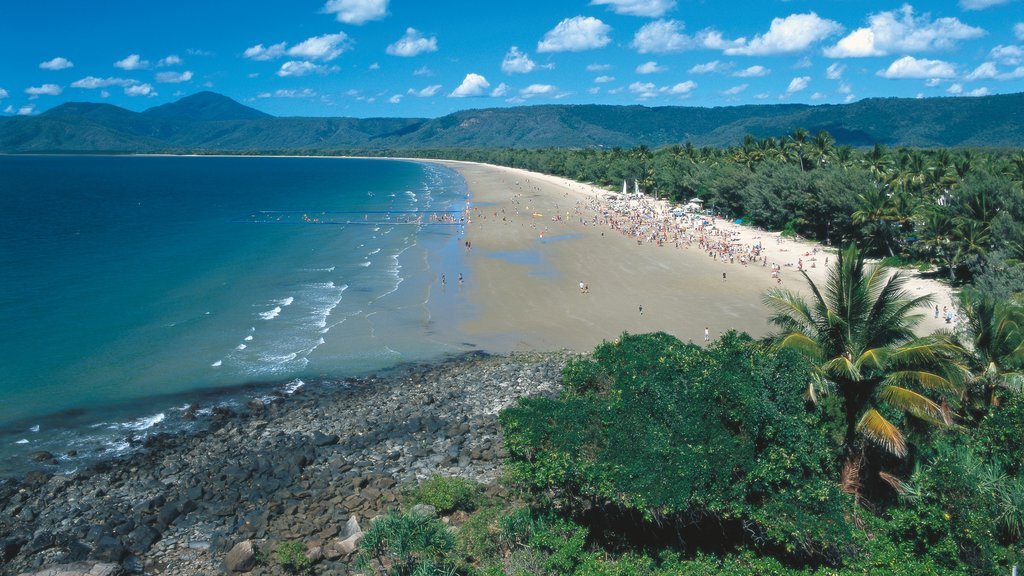 Port Douglas featuring landscape views, a sandy beach and rocky coastline
