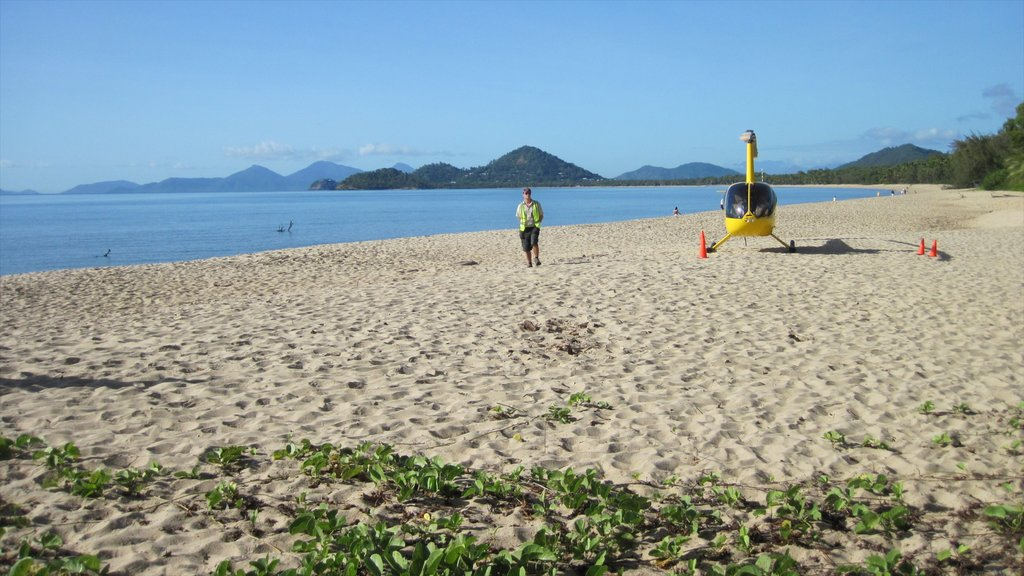 Palm Cove which includes landscape views, aircraft and an aircraft