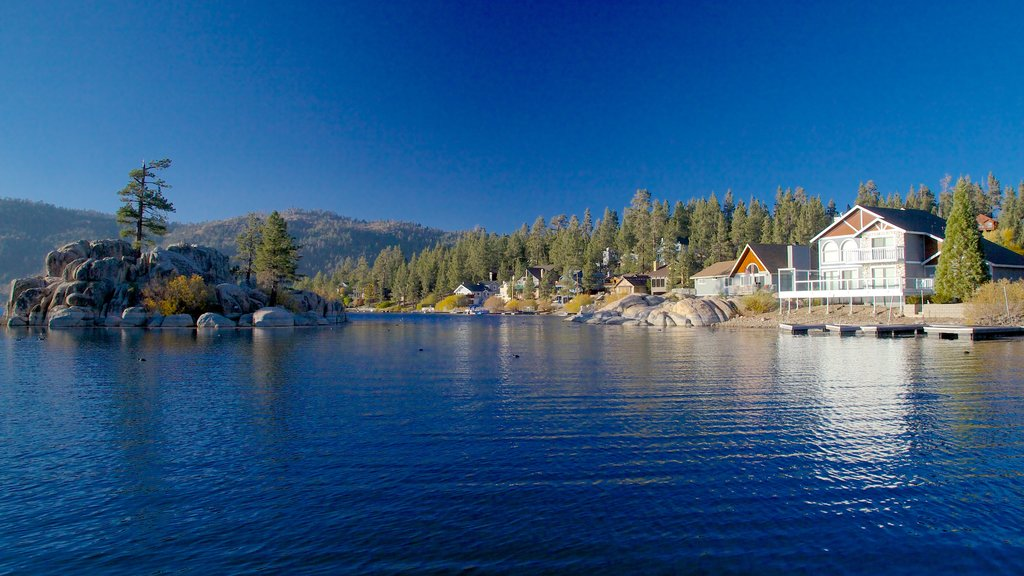 Southern California featuring a lake or waterhole, a house and mountains