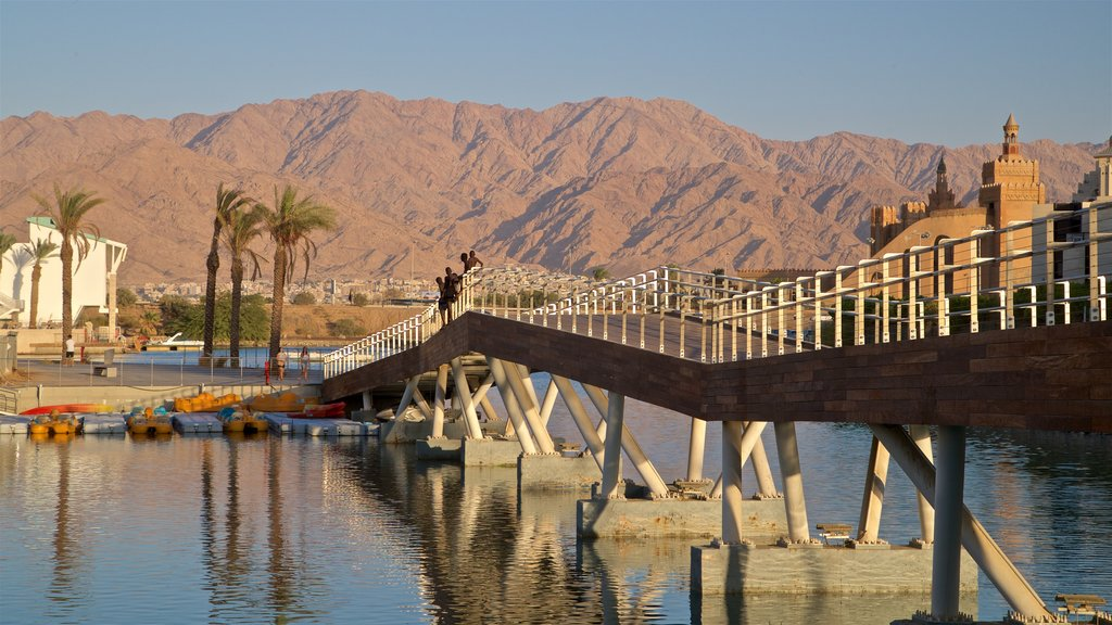 Eilat Marina which includes mountains, a river or creek and a bridge