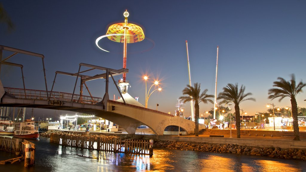 Eilat which includes night scenes, a bridge and a river or creek