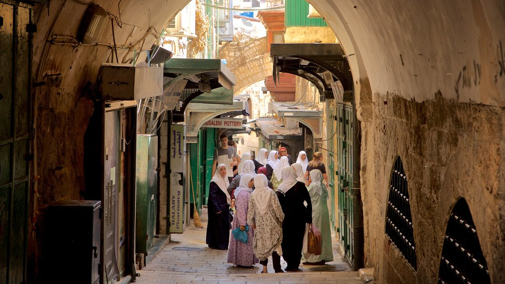 Jerusalem featuring street scenes as well as a small group of people