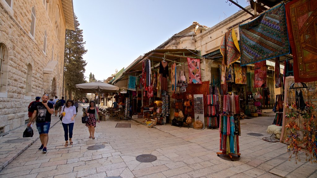 Mahane Yehuda Market featuring street scenes and markets as well as a small group of people