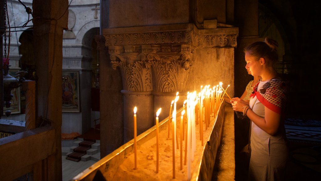 Church of the Holy Sepulchre featuring night scenes as well as a small group of people