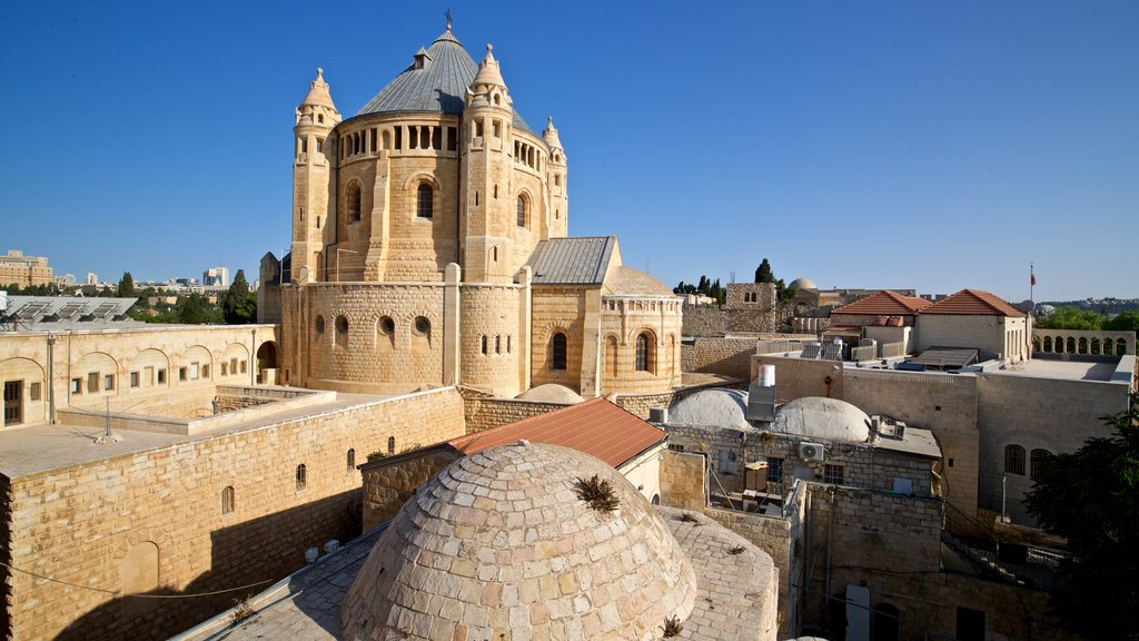 Dormition Abbey showing heritage architecture and a city