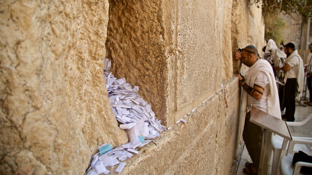 Western Wall which includes religious aspects and heritage elements as well as a small group of people