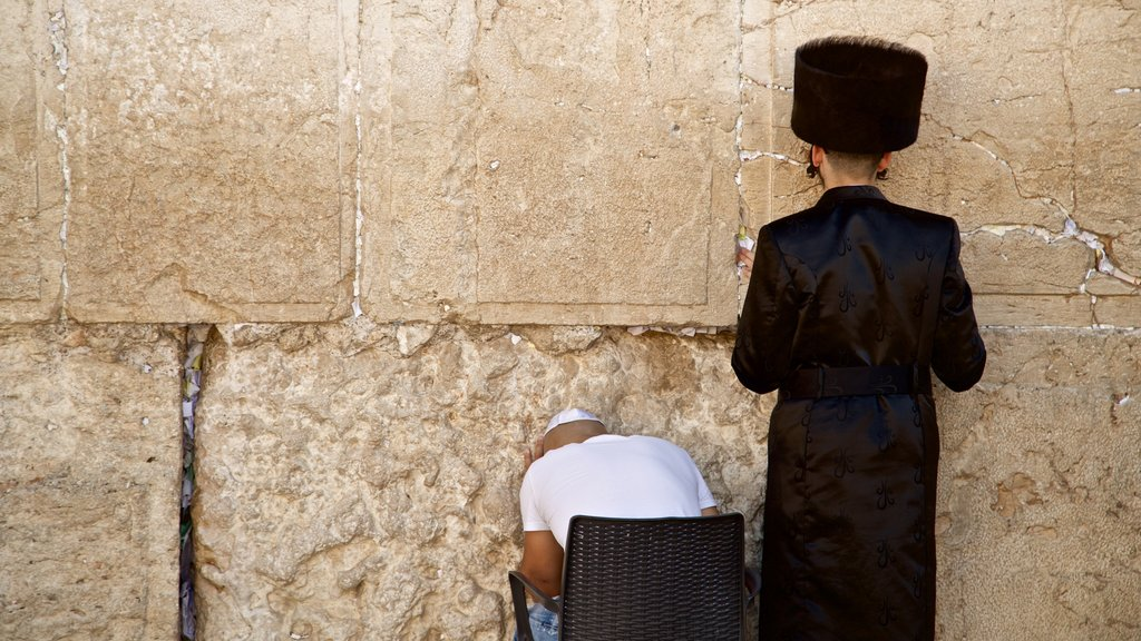 Western Wall showing heritage elements and religious elements as well as a small group of people
