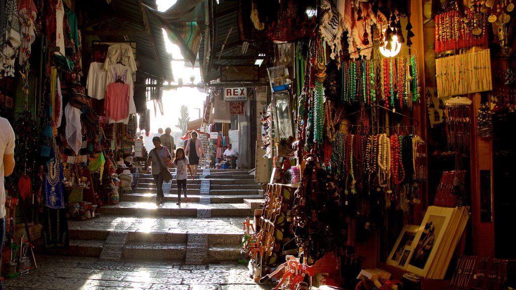 Mahane Yehuda Market which includes markets and interior views as well as a family
