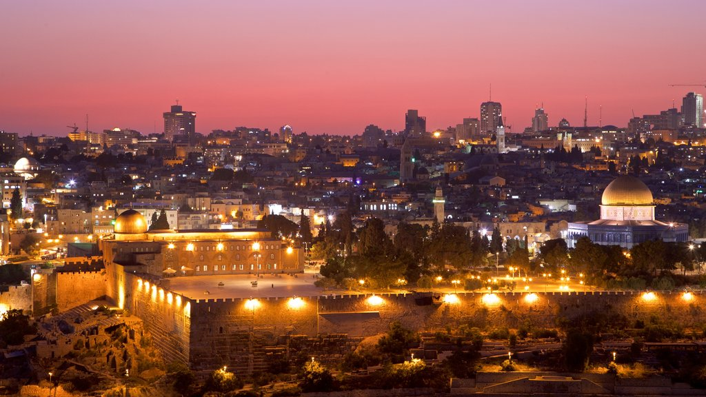 Temple Mount which includes landscape views, a city and a sunset