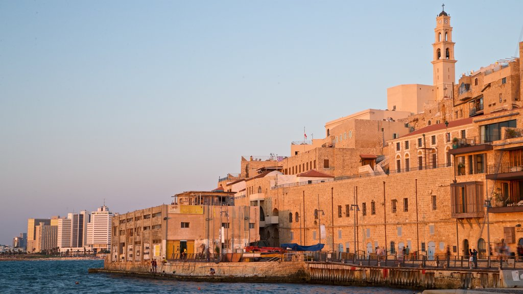 Jaffa Port showing a river or creek, a sunset and a city