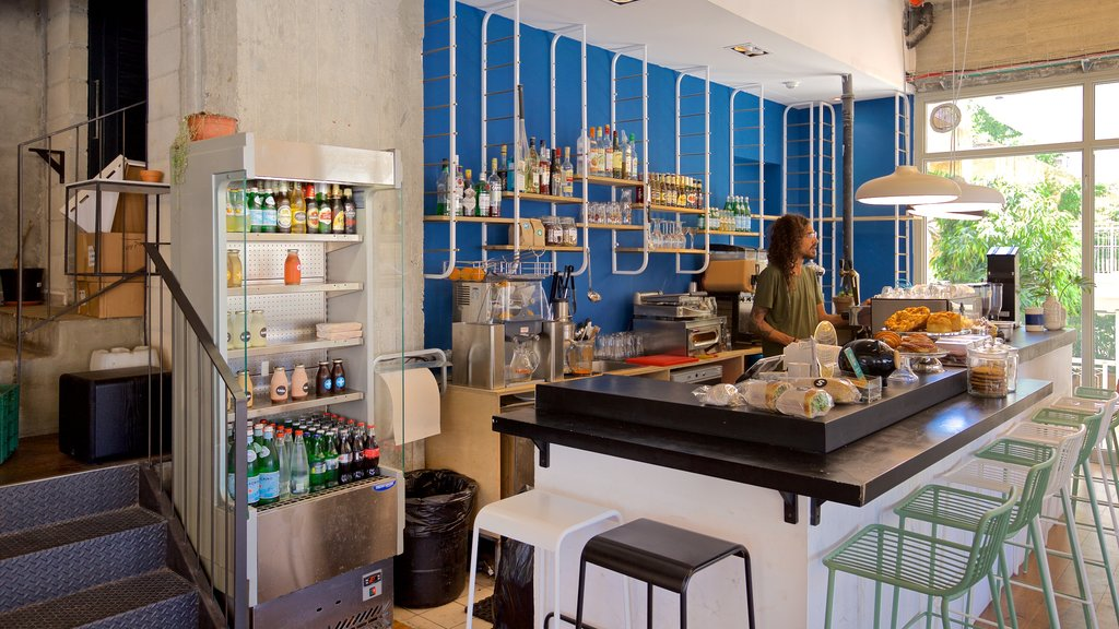 Jaffa featuring cafe scenes and interior views as well as an individual male