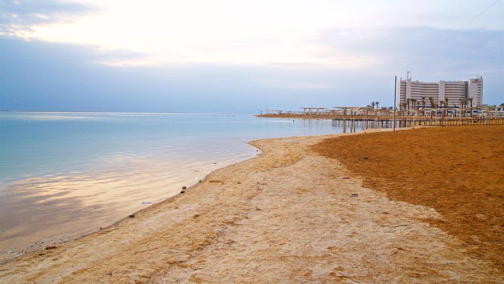 Ein Bokek which includes a sandy beach, a sunset and general coastal views