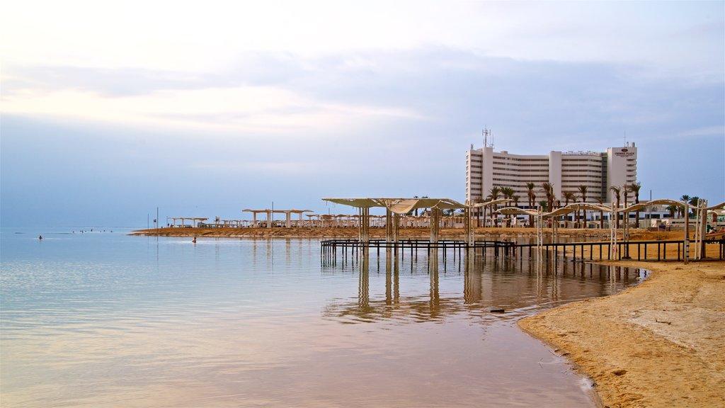 Ein Bokek which includes a beach, a coastal town and a sunset