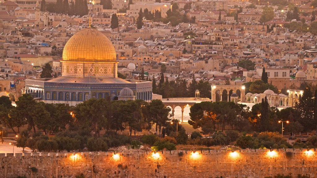Temple Mount showing a city, heritage architecture and a sunset