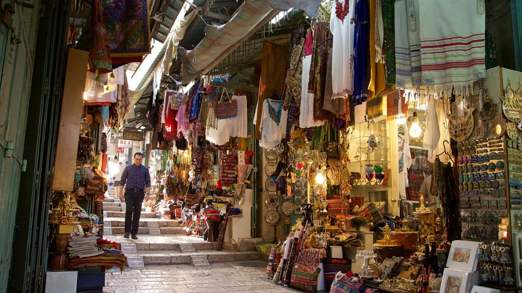 Mahane Yehuda Market featuring markets and street scenes as well as an individual male