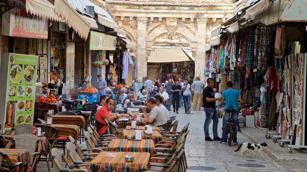 Mahane Yehuda Market which includes markets, outdoor eating and street scenes