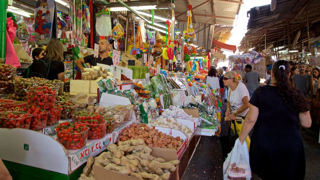 Carmel Market which includes food and markets as well as a small group of people