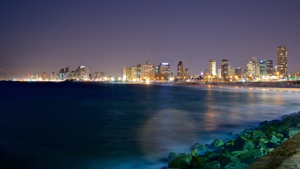 Jaffa Port featuring a city, night scenes and a coastal town