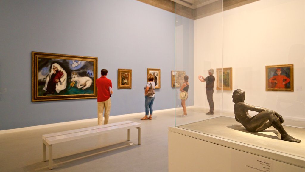 Tel Aviv Museum of Art showing art and interior views as well as a small group of people
