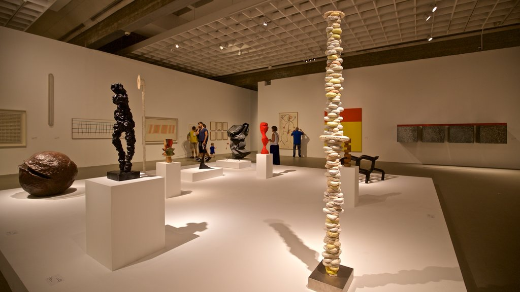 Tel Aviv Museum of Art featuring art and interior views as well as a small group of people