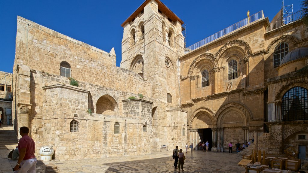 Church of the Holy Sepulchre showing heritage architecture as well as a couple