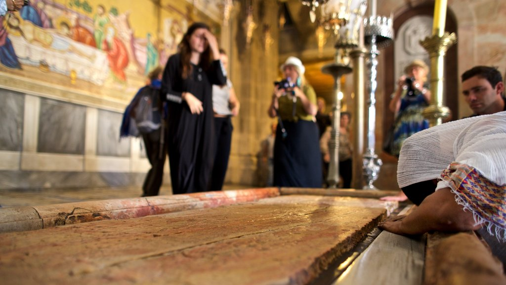 Church of the Holy Sepulchre which includes a church or cathedral, heritage elements and interior views