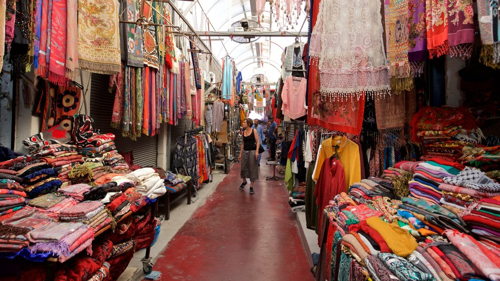 Jaffa Flea Market featuring markets and interior views as well as an individual femail