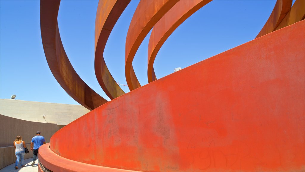Design Museum Holon featuring modern architecture as well as a couple