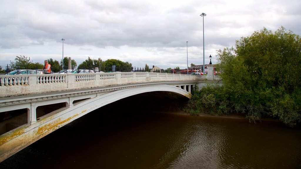 Warrington showing a river or creek and a bridge