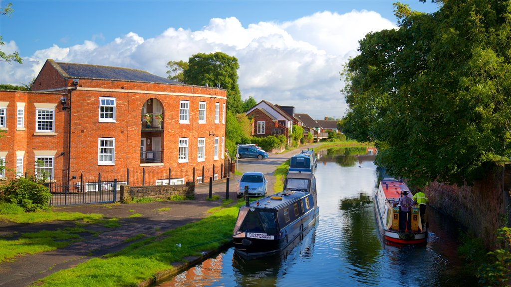 Lymm showing boating, a river or creek and a small town or village