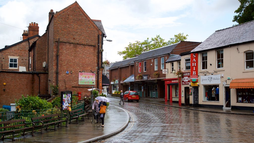 Lymm showing a small town or village and street scenes as well as a small group of people