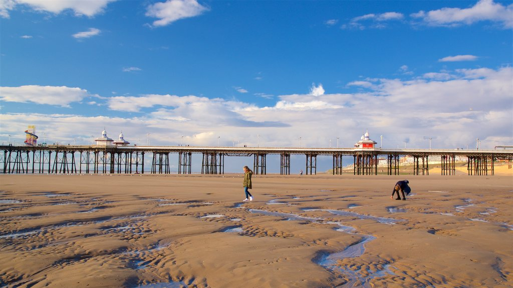 Blackpool Beach showing a sandy beach and general coastal views as well as a couple