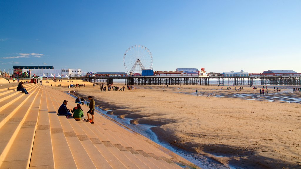 Blackpool Beach featuring general coastal views and a sandy beach as well as a small group of people