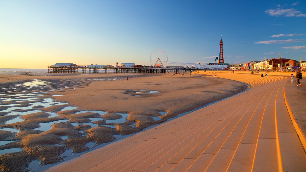 Blackpool Central Pier featuring a sunset, a sandy beach and general coastal views