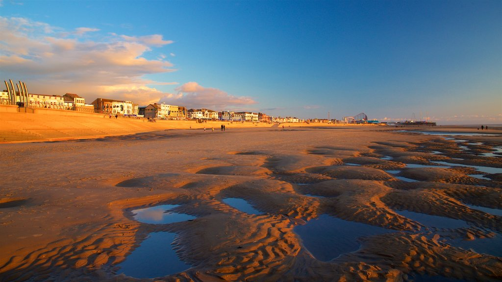 Central Beach which includes a sunset, a coastal town and general coastal views